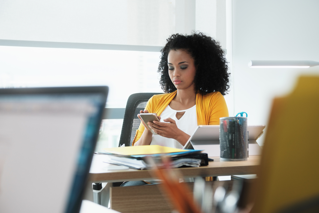 african-american-business woman reading email
